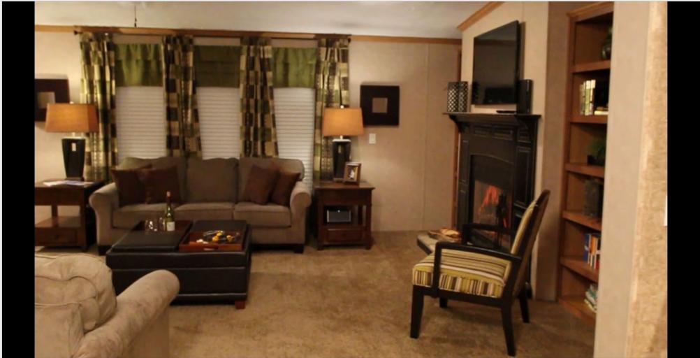 6-living-room2-kabco-tunica-show-32x70-manufactured-home-living-news-com-