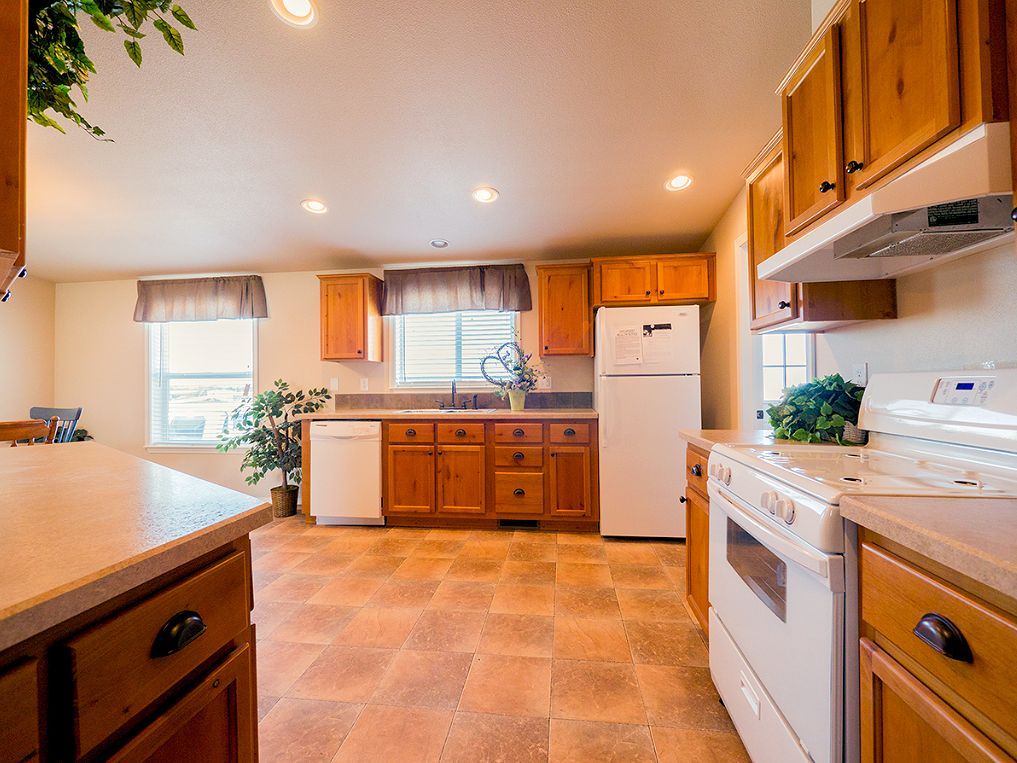 1b-avalanche-4523-kitchen-reverse-view-manufacturedhomes-com-manufactured-home-living-news-com-