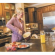 woman-cooking-kitchen-claytonhomes-therevew=credit-posted-manufacturedhomelivingnews-com-