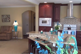 living-room-kitchen-umh-homes-model-MH-village-manufactured-home-living-news-2