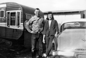 Bob Vasholtz and wife, by 1952 Rebel Trailer House,