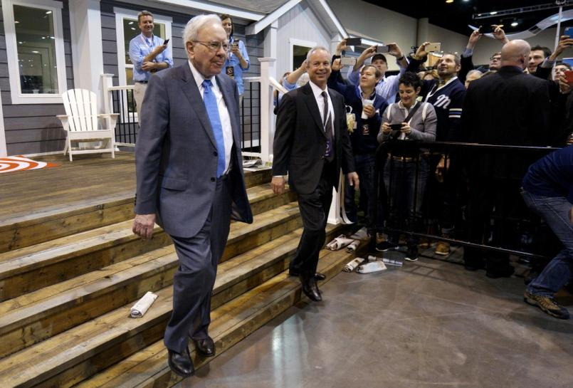 Berkshire Hathaway CEO Warren Buffett walks with Kevin T. Clayton, CEO of Berkshire Hathaway subsidiary Clayton Homes, out of one of the company's houses prior to the Berkshire annual meeting in Omaha
